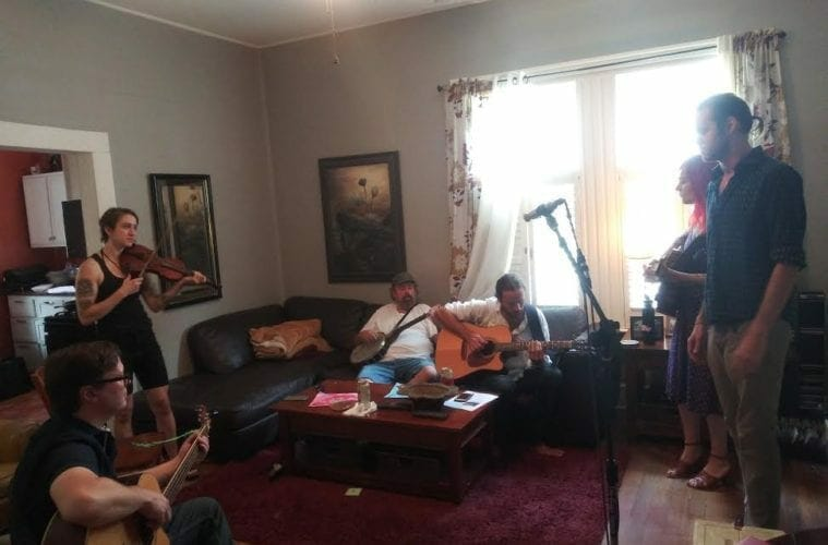 Cabbagetown musicians perform in an old home.