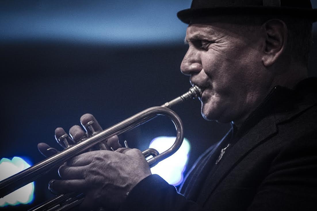 Gordon Vernick plays his trumpet.