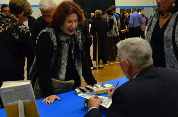 An author signs a book at the Marcus Jewish Community Center's annual book festival.