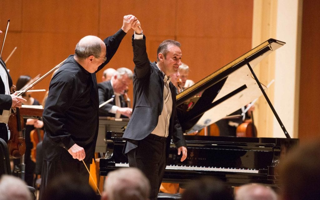 Spano and guest pianist Simon Trpčeski acknowledge the audience's ovation. (Photos by Jeff Roffman)