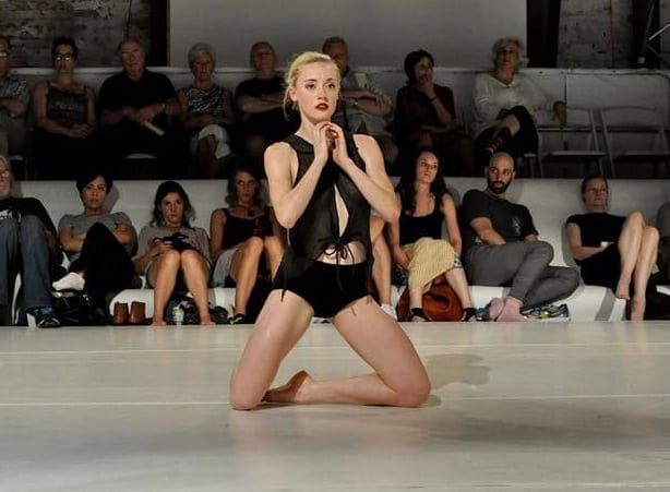 Noelle Kayser dancing with glo at the Goat Farm Arts Center.