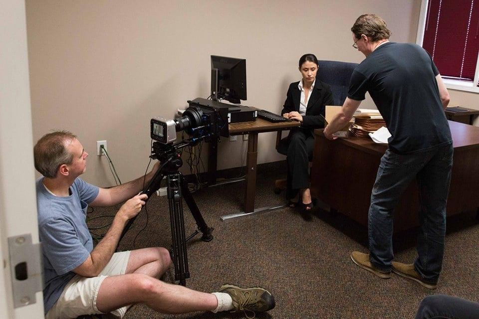 Nadia Mara on the set with cinematographer Jason Greene (left) and director Adam Stone. (Photos by Michelle Greene)