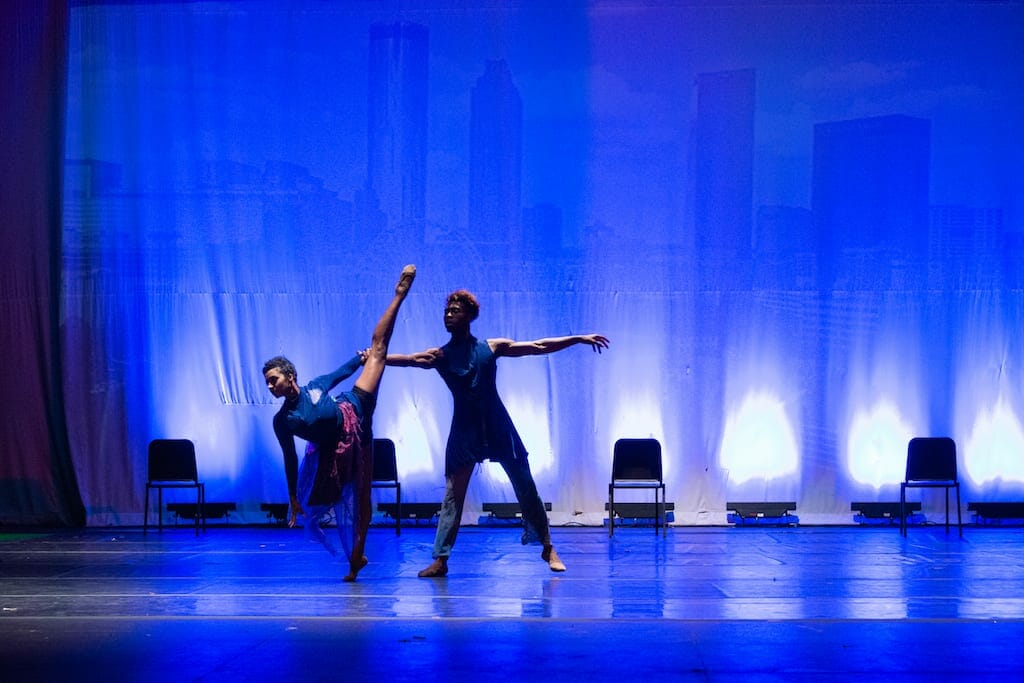 Two dancers from Atlanta Dance Connection on stage in soft light.