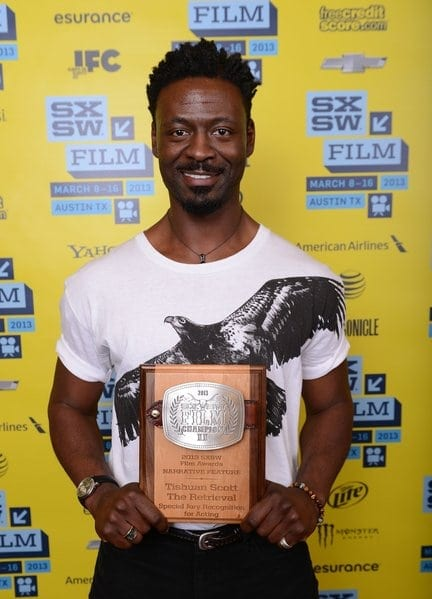 Tishuan Scott, with his SXSW plaque for acting that also doubles as a belt buckle.