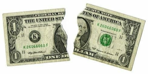 A ripped dollar bill represents arts funding