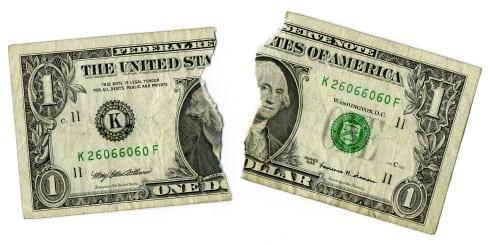 Ripped dollar bill  Economy Concept Image