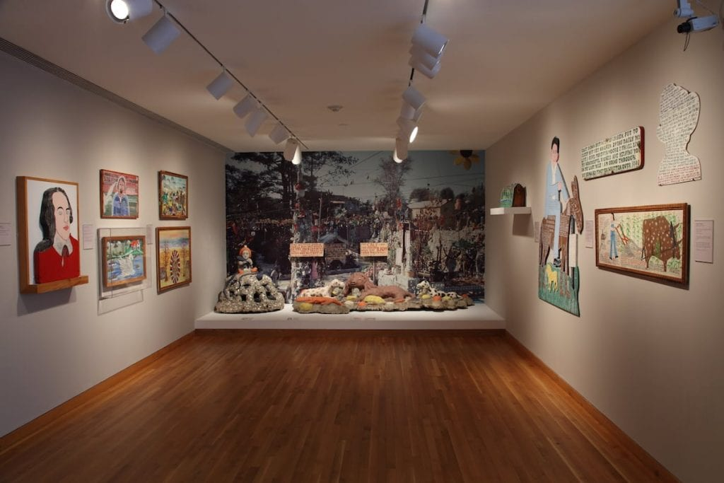 "High Museum Folk and Self-taught art Curator Katherine Jentleson favors a more ""environmental experience"" for viewers of folk art, such as in the High's long-running Howard Finster gallery, instead of what she terms ""the traditional spaced out, eye-level hang,"" (Image courtesy the High Museum of Art)"