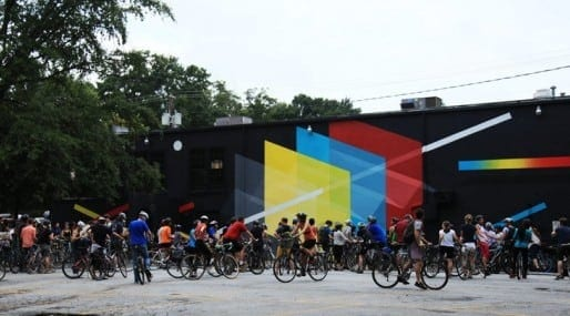 A stop on annual  bicycle tour of Living Walls murals.