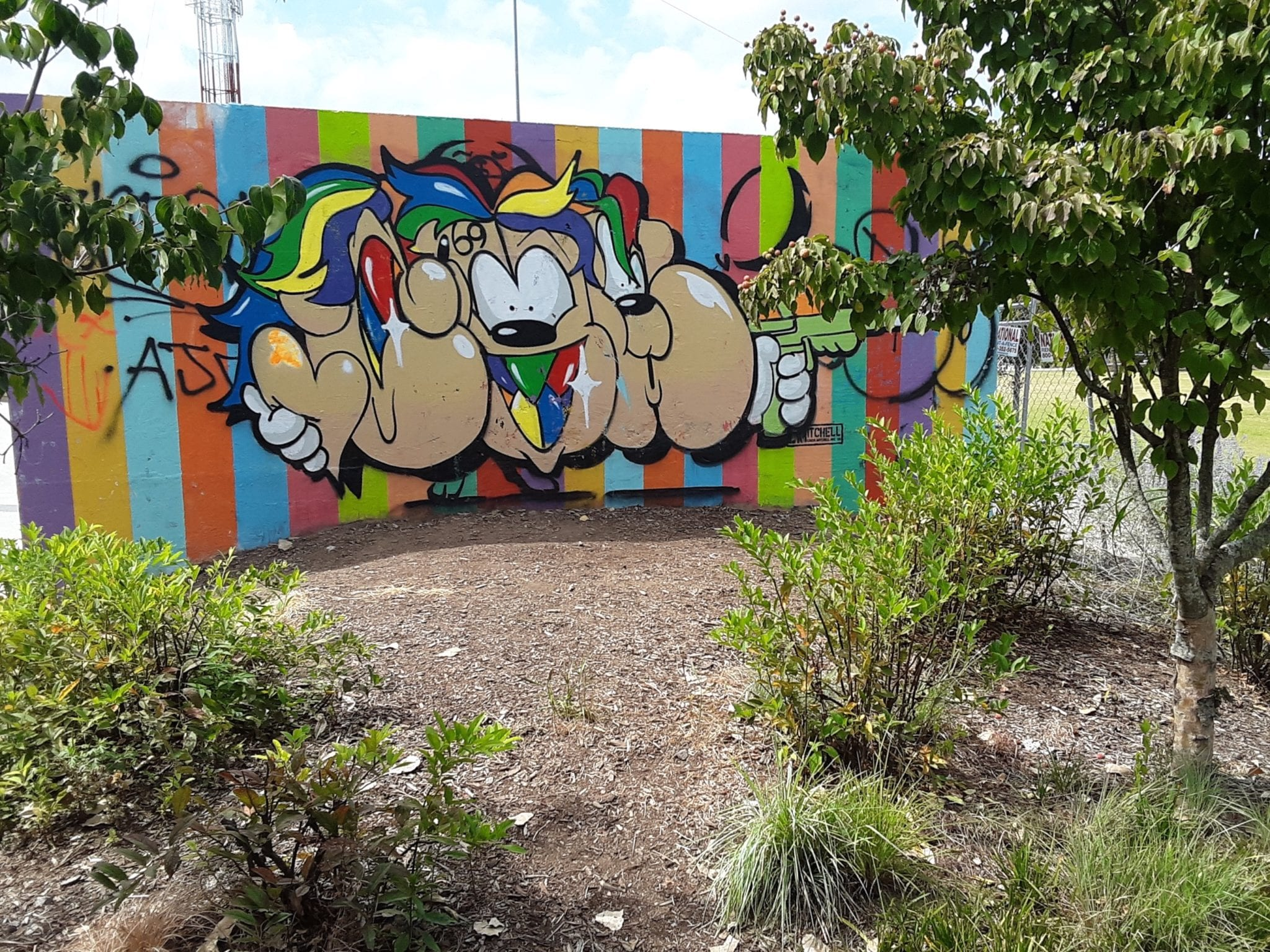 "Atlanta BeltLine mural ""Rainbow Pupper"" covered with graffitti"