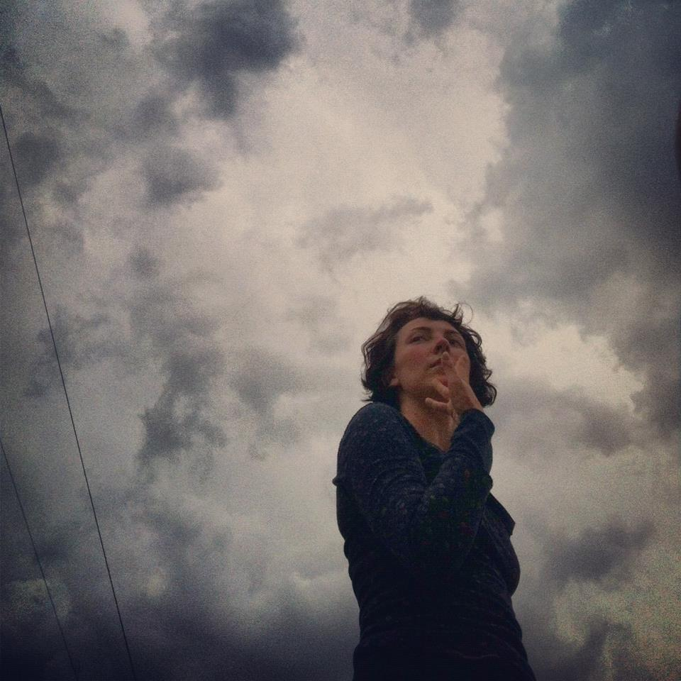 Dance artist Nicole Johnson under a cloudy sky.