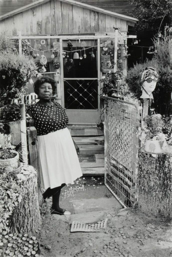Nellie Mae Rowe in her yard