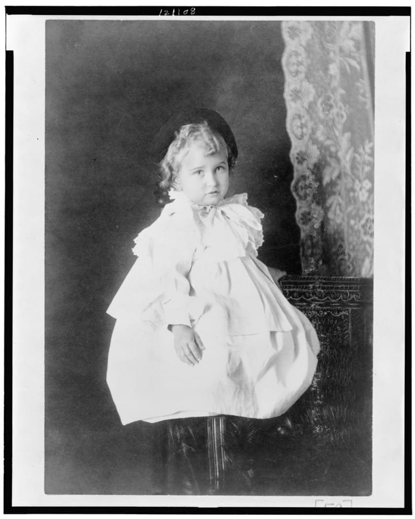 """Thomas Askew: """"African American girl, full-length portrait, seated on stool, facing slightly right."""" (est. date1899 or 1900). Silver gelatin. Image courtesy the Library of Congress."""