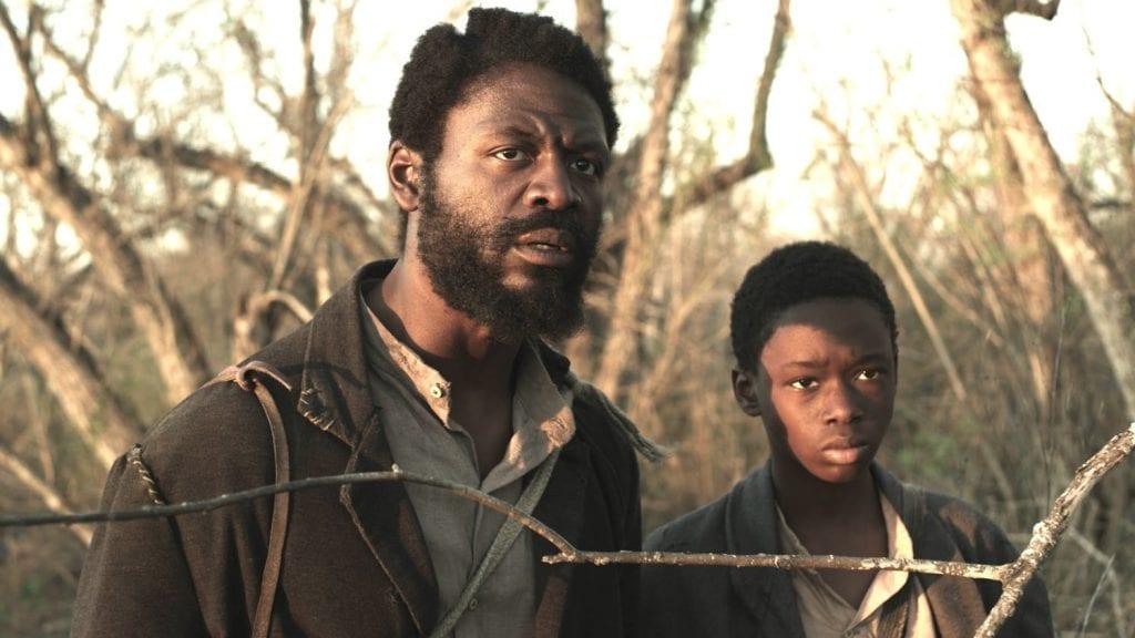 Tishuan Scott (left) and Ashton Sanders on the hunt for runaway slaves.