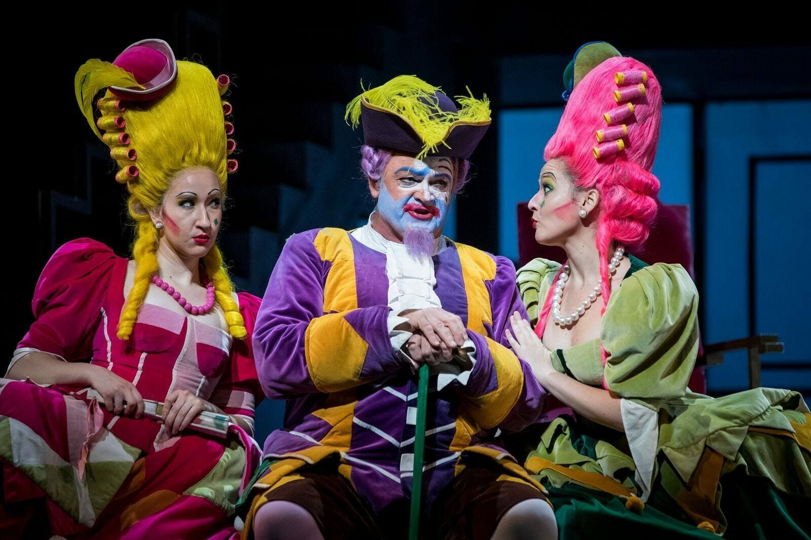 Three singers in full costume perform for The Atlanta Opera.