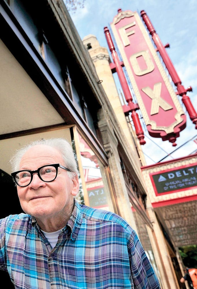 Patten outside his beloved theater, where he also lived for over 40 years.