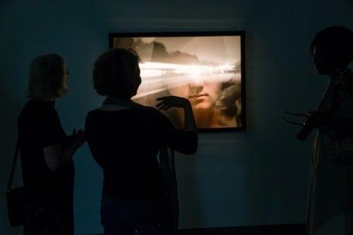 "Visitors view Charlie Watts' ""I-20"" at Emory University's Visual Arts Building Gallery. (Photo by John Ramspott)"