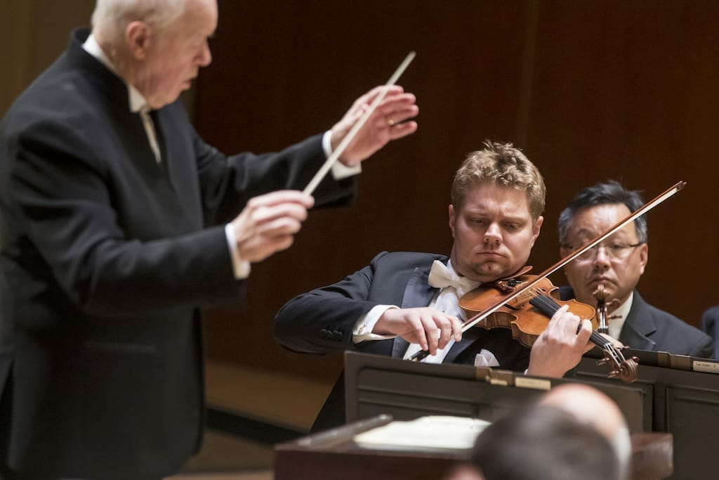 A guest conductor with violinist David Coucheron performing a solo.