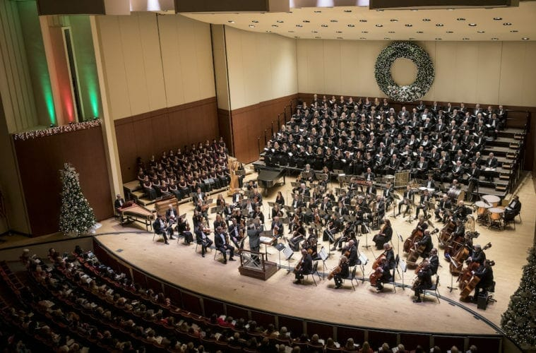 """Musicians and chorus on stage for the Atlanta Symphony Orchestra's """"Christmas with the ASO"""" program."""
