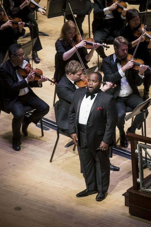 """Tenor Timothy Miller on stage with the Atlanta Symphony Orchestra for the """"Christmas with the ASO"""" program."""