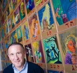 Archie Rand with his 1,700-square-foot cartoon depiction of the Torah's 613 commandments.