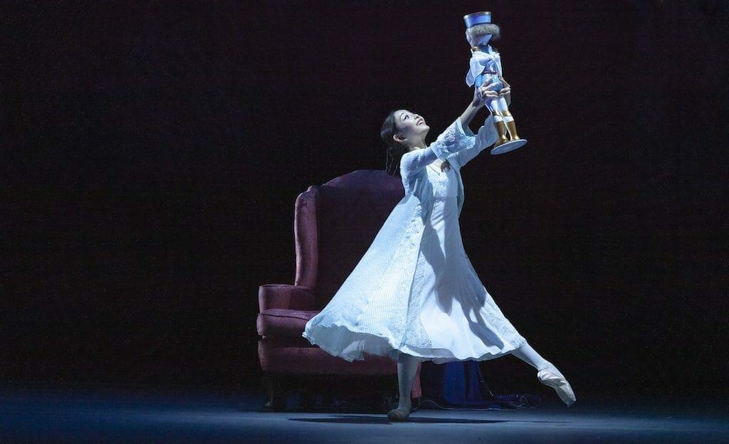 A ballet dancer holds The Nutcracker.