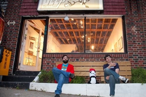 Mark Bashore and James O'Connell relaxing in front of their gallery.