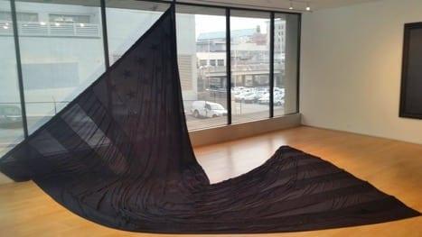 """Black Cotton Flag Made In Georgia"" (2016). Black cotton, black thread, black sweat, black blood, black labor, 14'x27'"