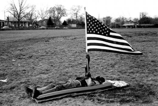 Steve Shapiro: Boy on ground with flag, Selma, 1965.