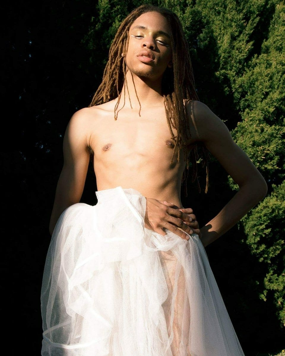 Atlanta's MonteQarlo poses in a stripped down wedding gown.
