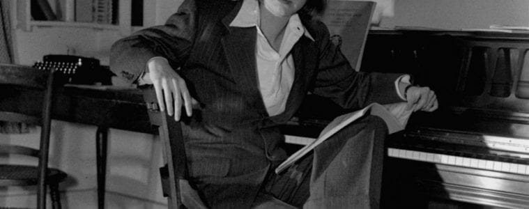 Carson McCullers seated at her desk.