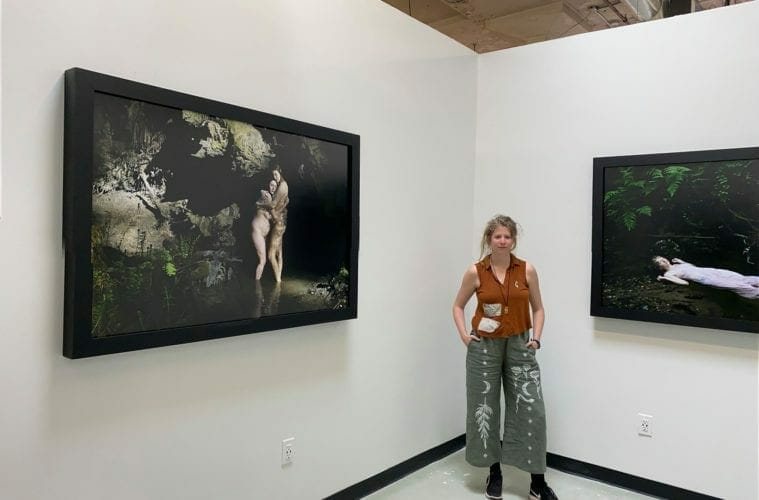 Photographer Charlie Watts stands in front of her works.