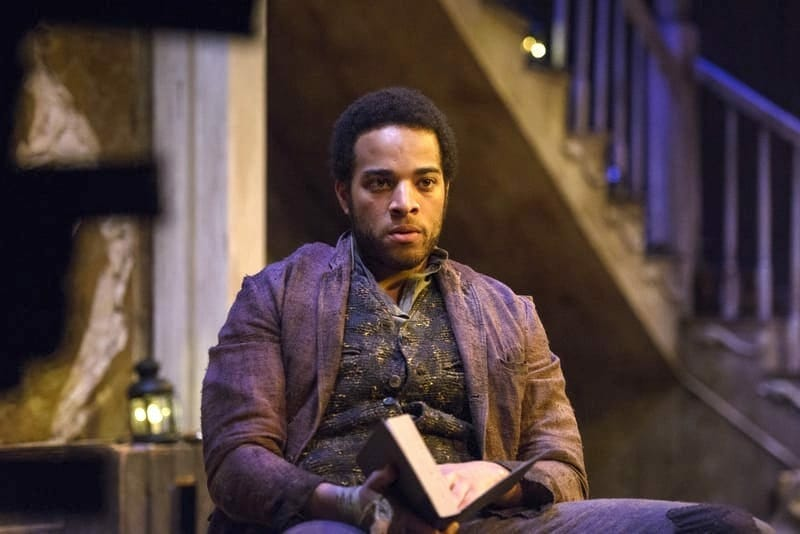 "John Clarence Stewart reads from a book in the Alliance Theatre's ""The Whipping Man"" play."