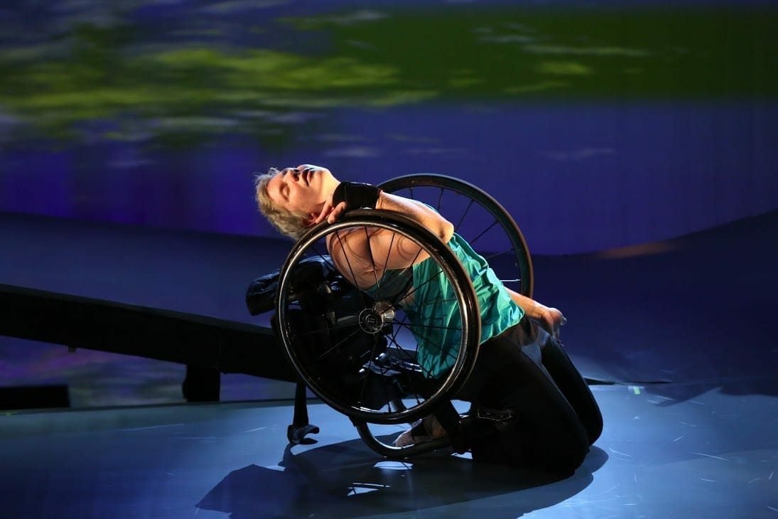 A disabled dancer from Kinetic Light performs solo.