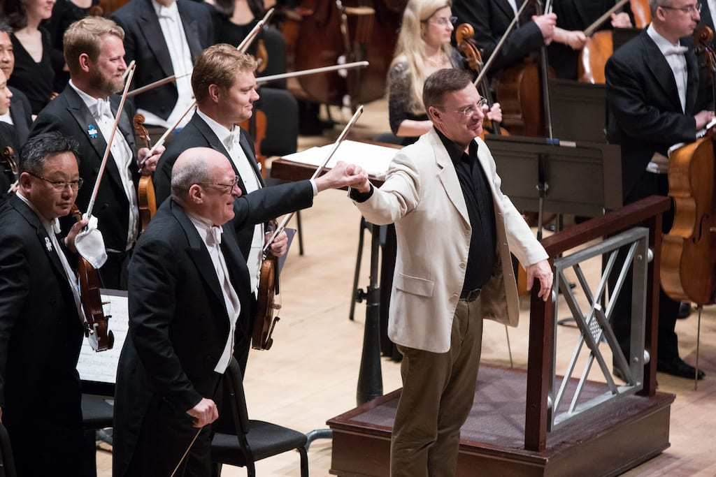<em>Composer and Emory University's Richard Prior came on stage for bows with Spano after the performance.</em>