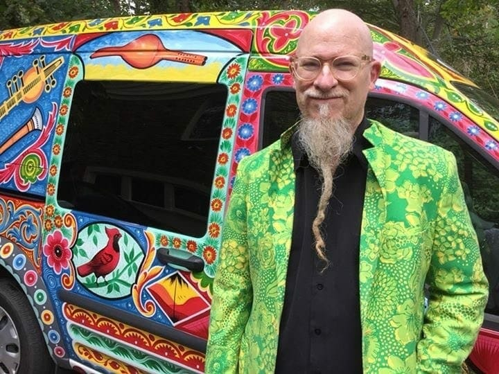 Klimchak standing by his colorful van.