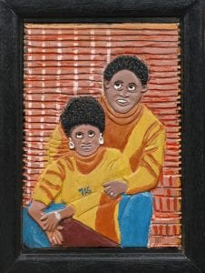 """Elijah Pierce(American, 1892-1984),Mr. and Mrs. Hank Aaron, 1974, wood and paint. Gift of Gordon W. Bailey in honor of Henry """"Hank"""" and Billye Suber Aaron."""