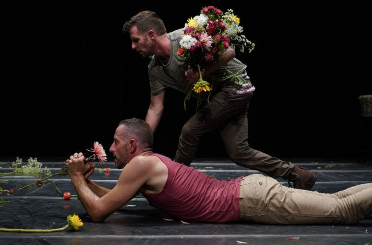 "Two men dance in ""The Third Dance."""