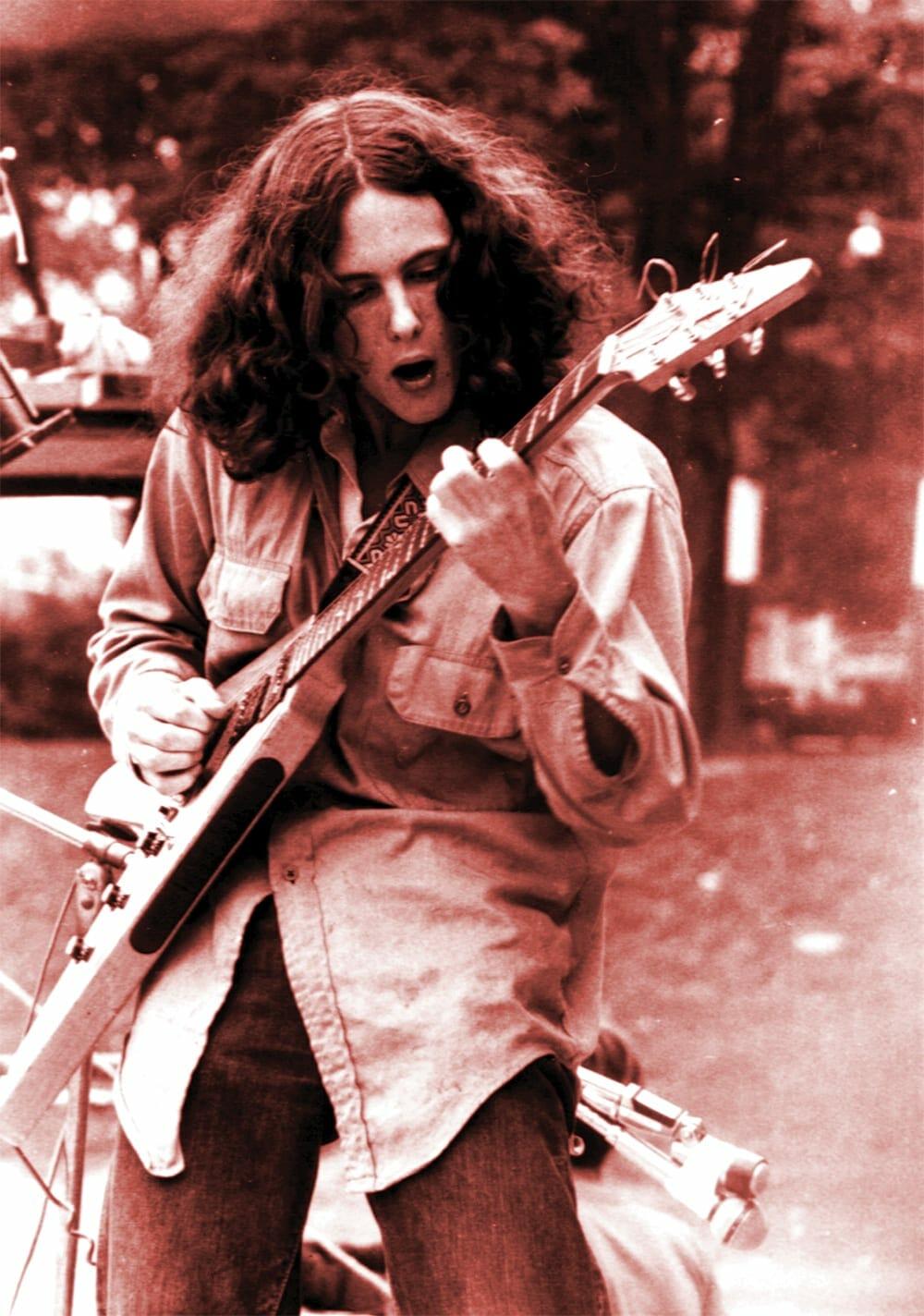 Glenn Phillips plays guitar in Piedmont Park.