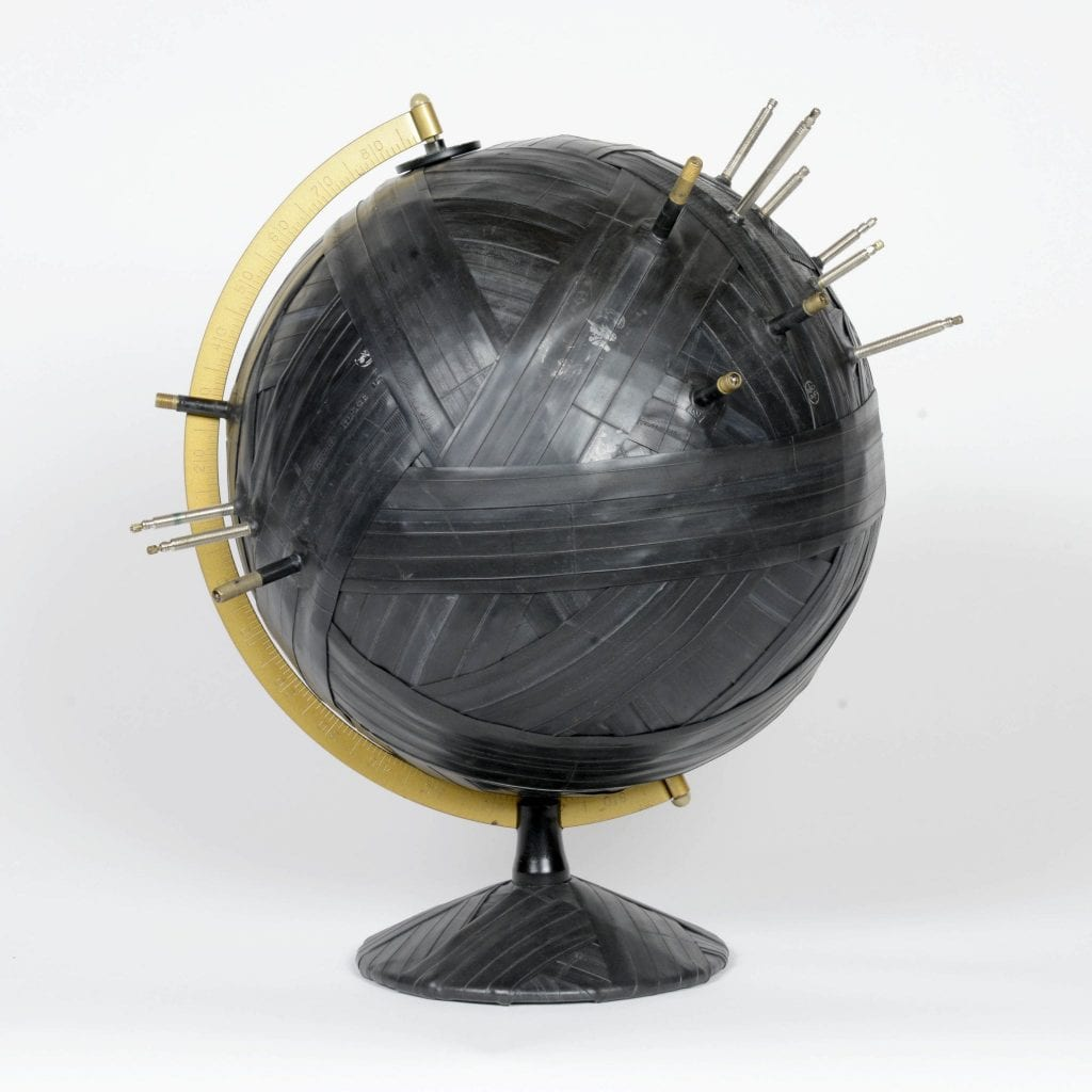 "Bound Globe #9 (Dangerous Places) - 18"" x 16"" x 16"" Cardboard, metal and inner tubes with valve stems, 2016. Photo courtesy the artist."