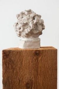 Amy Pleasant: Head III. Clay on cedar pedestal.
