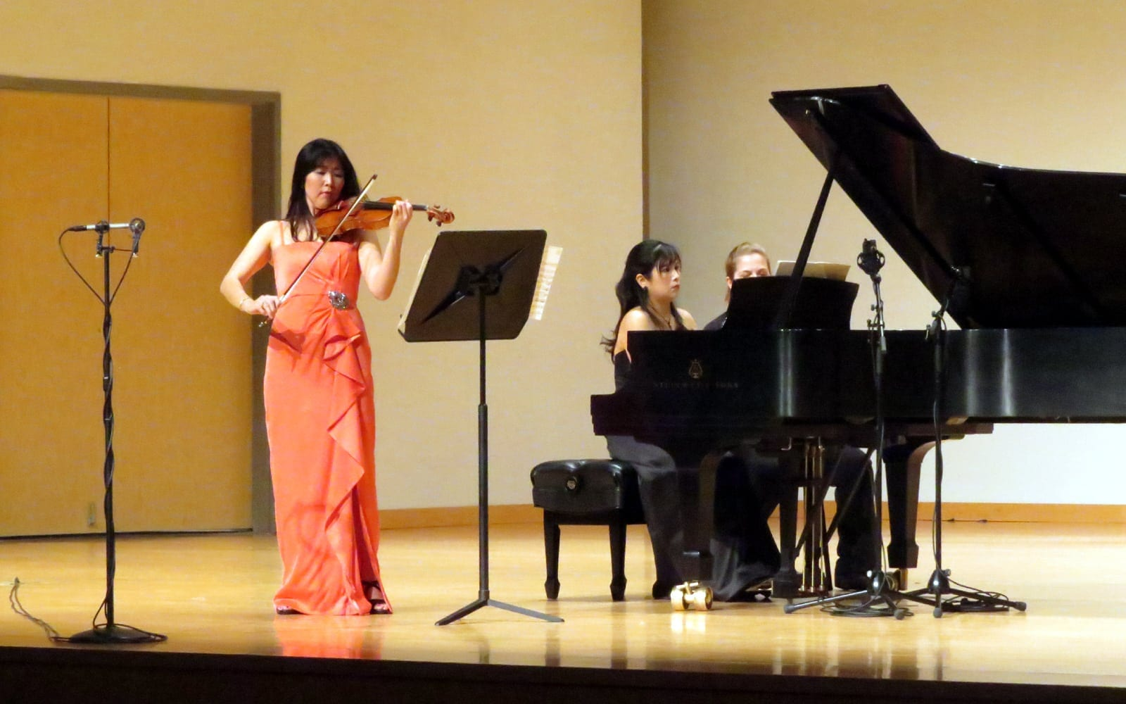 Kim with pianist at her faculty recital. (Photo by Mark Gresham)