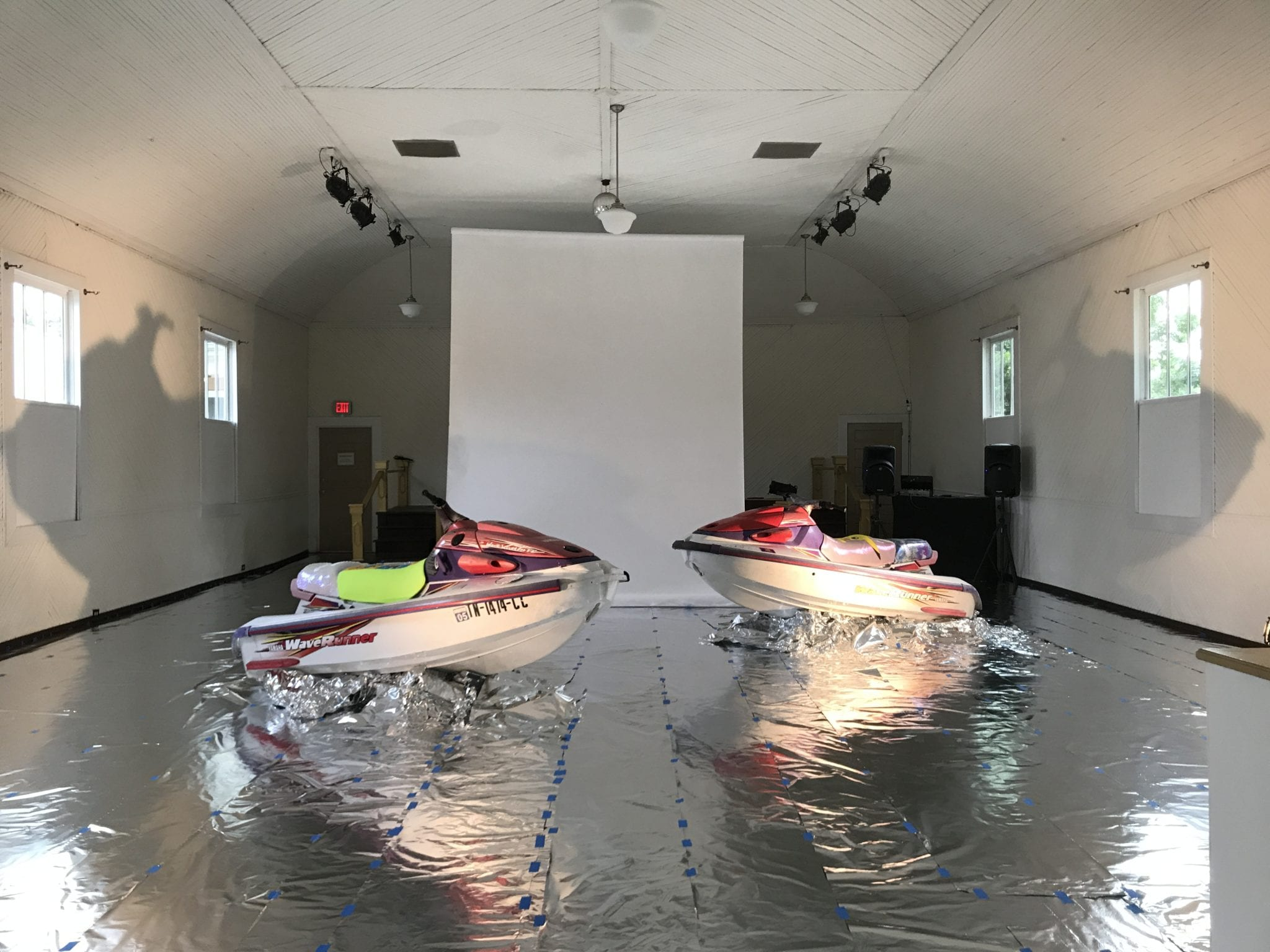 An abstract gallery view of work consisting of two jet skis