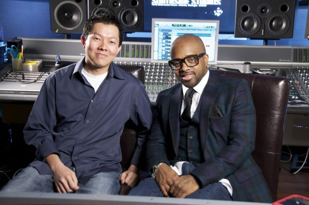 Phil Tan sits in a recording studio with Jermaine Dupree.