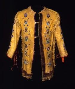 Jacket, Apsaalooke (Crow), Montana, ca. 1885. Deerskin, paint, fringe, cloth, otter fur, ribbon, seed beads and horsehair.,
