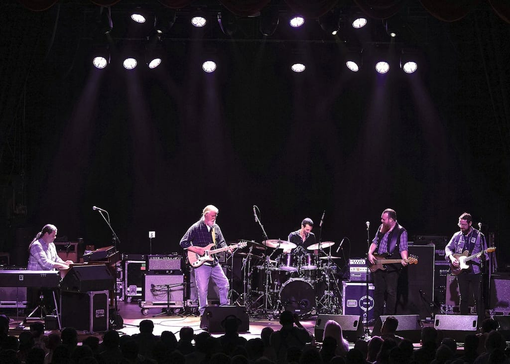 Jimmy Herring and the 5 of 7 perform on stage.
