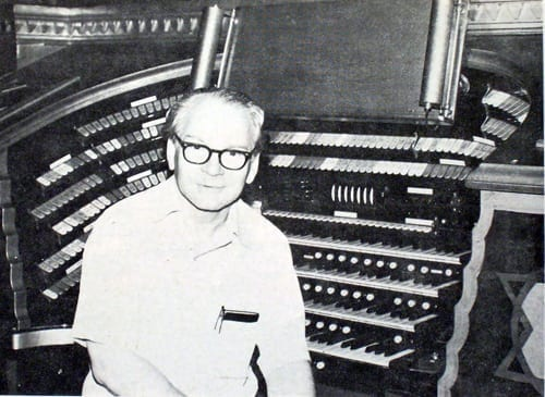 """Patten with """"Mighty Mo,"""" the house organ that he restored."""