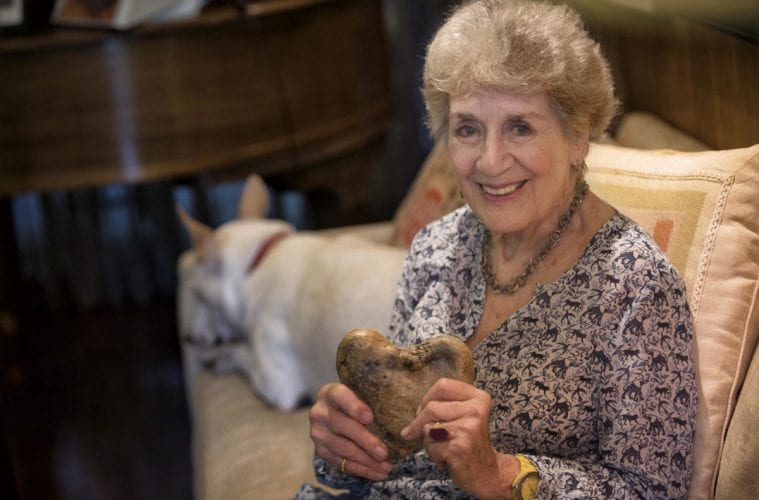 Atlanta photographer Lucinda Bunnen at home with one of the heart-shaped rocks she collected