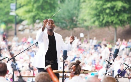 Assistant ASO conductor Joseph Young at the symphony's second concert at Piedmont Park this month. Photo by Jeff Roffman.