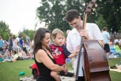 ASO bass player Michael Kurth shows off his contrabass.to concert attendees at Piedmont Park. Photo by Jeff Roffman.