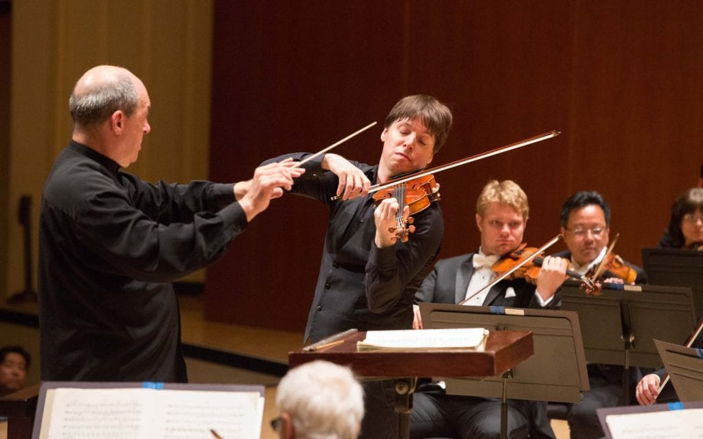 Spano with guest violinist Joshua Bell. (Photos by Jeff Roffman)